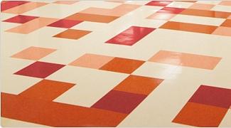 Solid color vinyl floor tiles